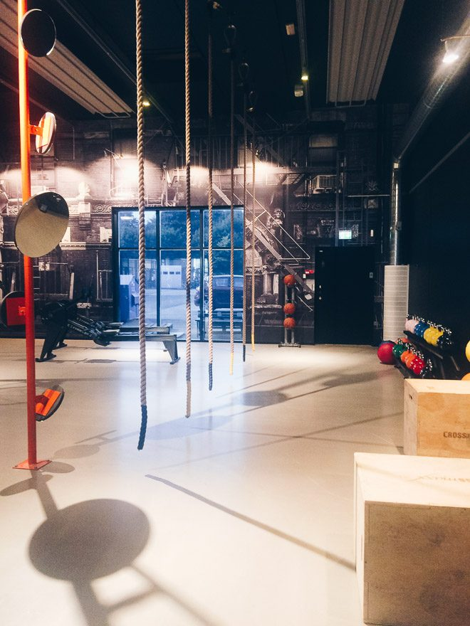 Gym with ropes for climping, crates for jumping and colorful kettlebells