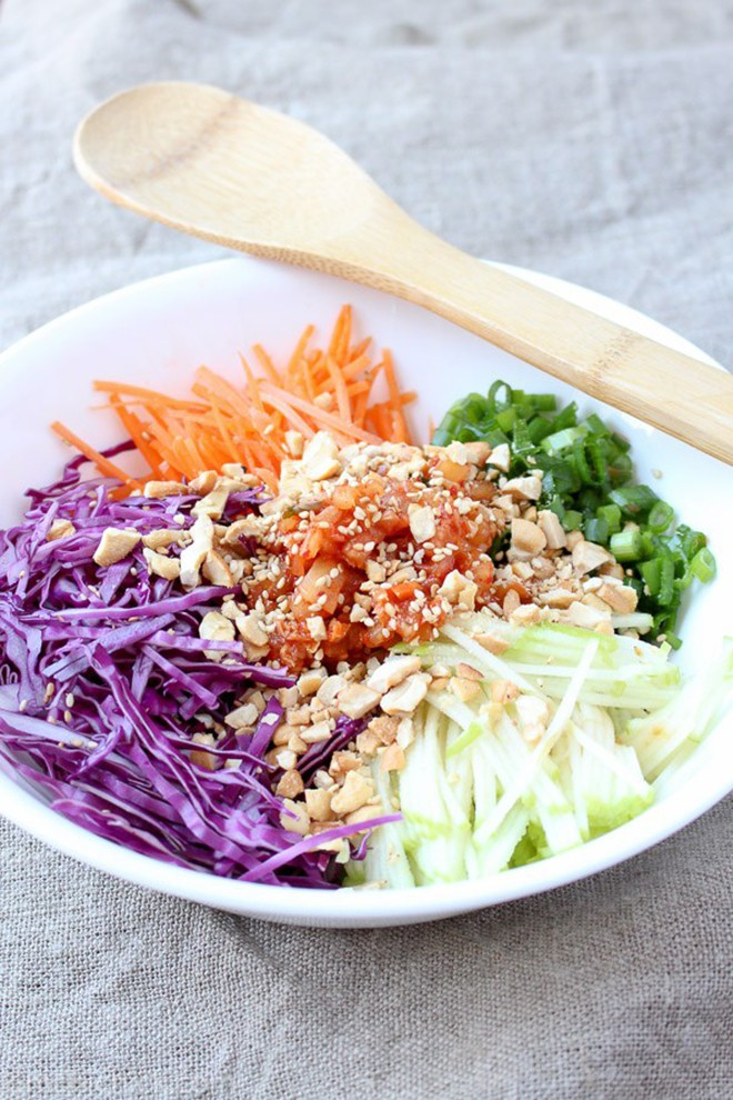 Here's a recipe for a refreshing kimchi slaw with sweet and spicy vinaigrette.