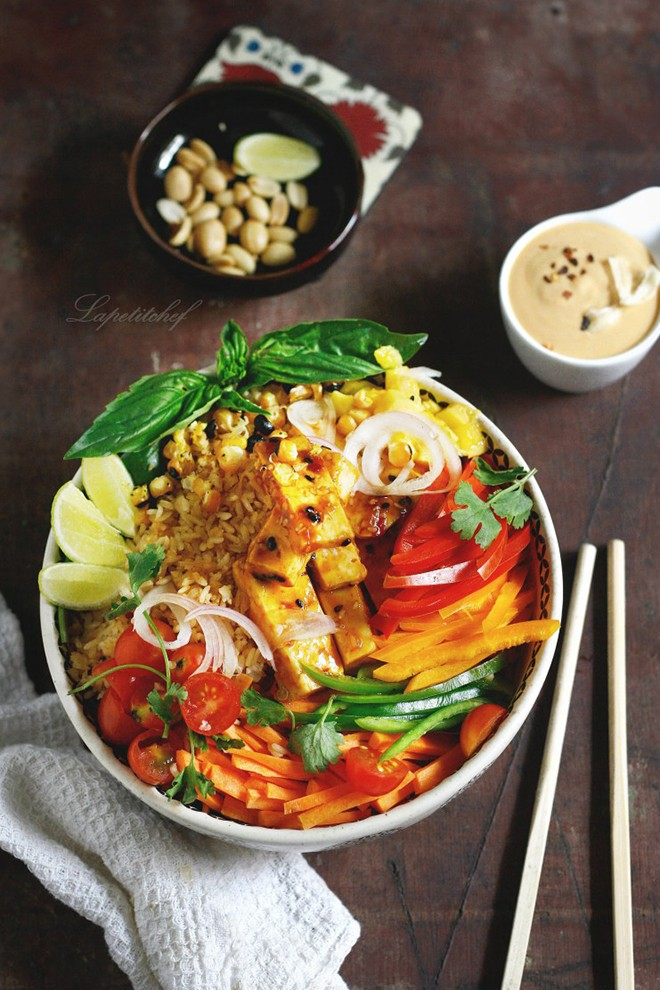 Here's a yummy vegan buddha bowl loaded with brown rice, marinated tofu, fresh vegetables and herbs; lapetitchef.jpg