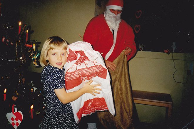 Anne receiving a big present from Santa Claus