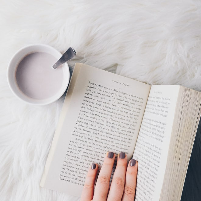Open book with a cup of hot cocoa